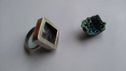 Geometric ring with a sparkling blue stone